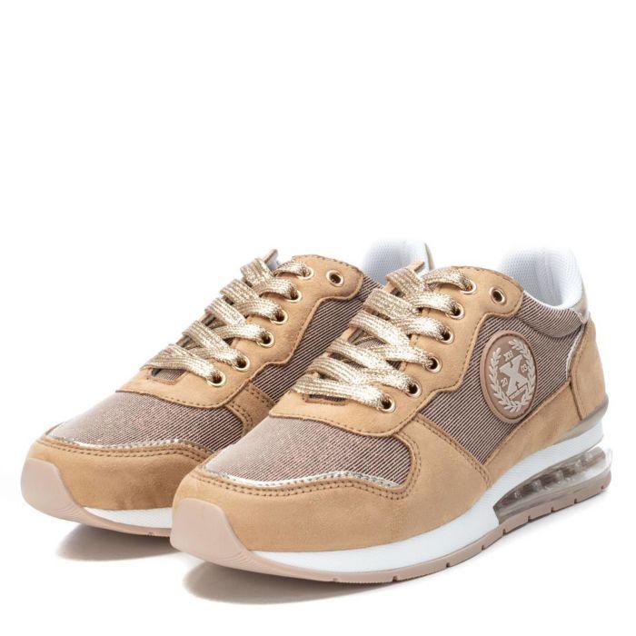 Zapatillas tipo sneakers doradas de Pasodoble en Palencia.
