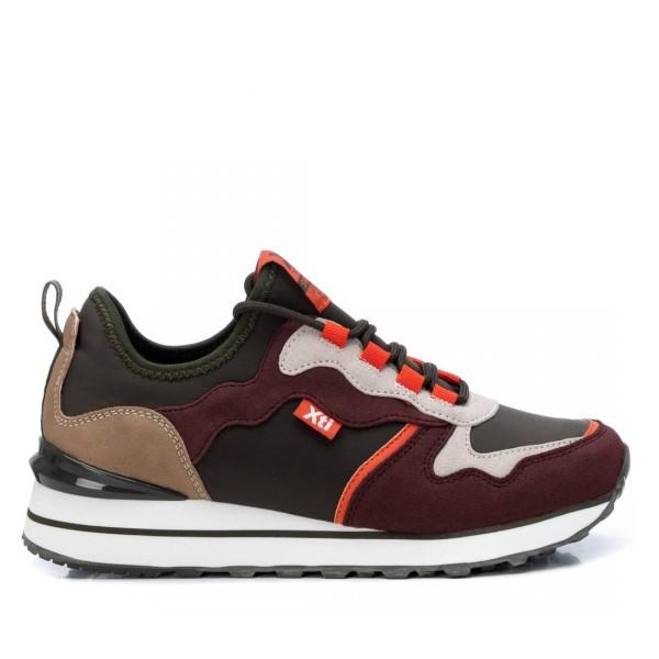 Sneaker en marrón y naranja de Pasodoble en Palencia.