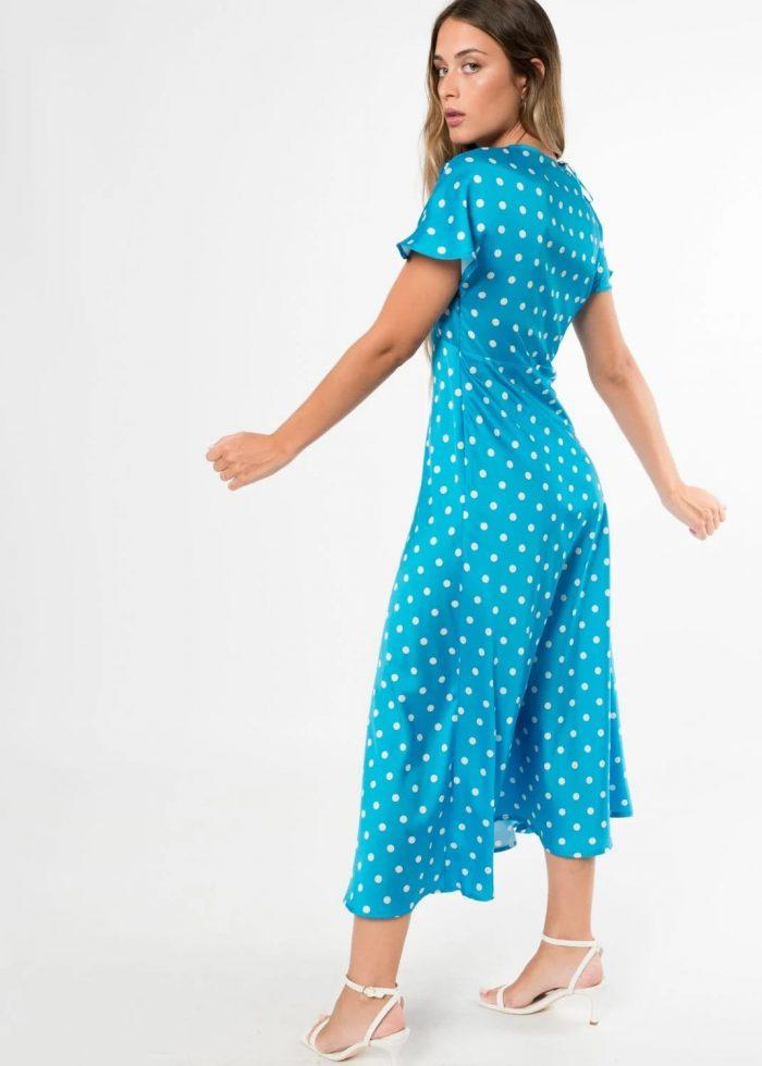 Vestido azul con luVestido azul con lunares blancos de Pasodoble en Palencianares blacon de Pasodoble en Palencia